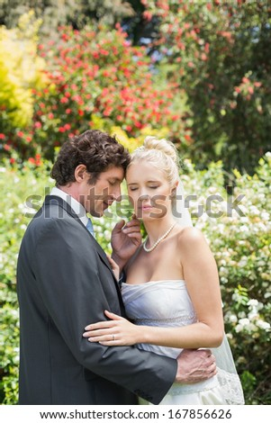 Romantic newlyweds embracing in the countryside
