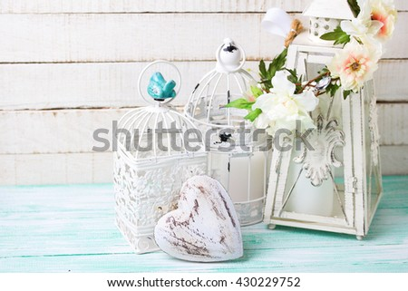 Romantic or wedding background.Decorative heart, flower wreath and decorative lanterns with candles on wooden background. Selective focus. Place for text. - stock photo