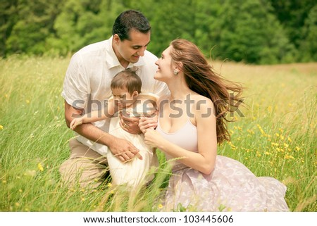 Romantic Outdoor Mixed Race Family with Father, Mother and Baby Son - stock photo