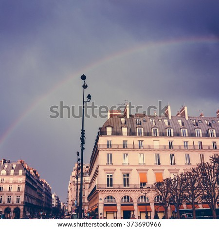 Romantic Paris. Street View with Rainbow in the Sky After Rain. Traditional French Architecture. Season Vacation Concept. Image Toned with Instagram Effect.