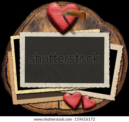 Romantic Photo Frames on Section of Tree Trunk / Blank aged romantic photo frames on trunk with red hearts and folding knife  - stock photo