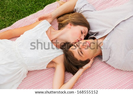 Romantic Picnic In The Park Loving Couple Cuddling On Blanket Outdoors Grass