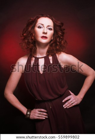 Romantic portrait of young charming woman with ginger hair.