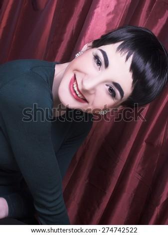 Romantic portrait of young happy brunette in retro style. - stock photo