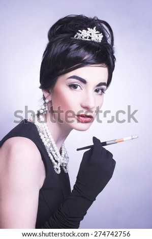 Romantic portrait of young smoking brunette in retro style. - stock photo