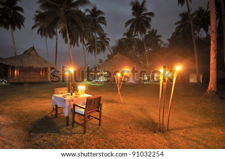 Romantic Private Dinner at Luxurious Resort - stock photo