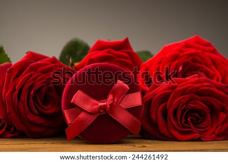 Romantic red roses with box gift. Valentine day background. - stock photo