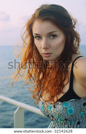 Romantic redhead relaxing outdoors