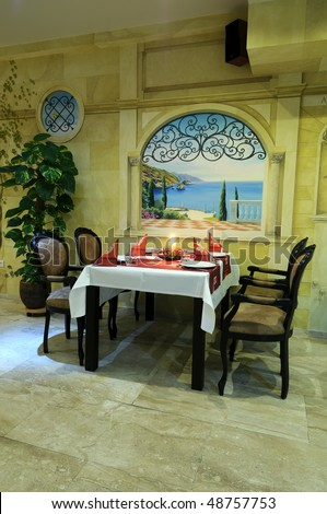 Romantic restaurant interior with served table. - stock photo