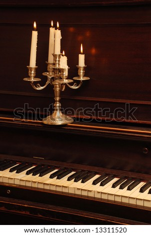 Romantic Retro Wood Piano In The Candle Lighting - stock photo
