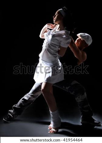 romantic salsa dancing couple on move - stock photo
