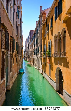 Romantic scene with colorful houses in Venice, Italy - stock photo