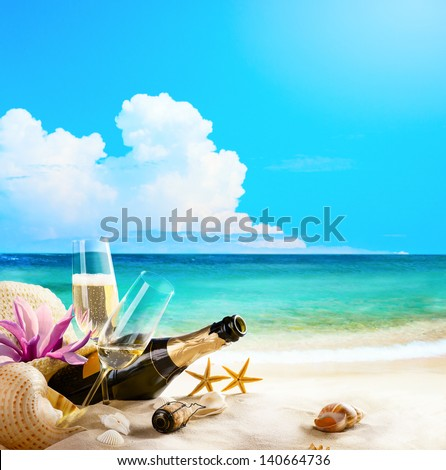 romantic sea beach. wine Glasses and Champagne Bottle on sand - stock photo