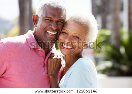 Romantic Senior Couple Hugging In  Street - stock photo