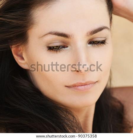 romantic sexy beautiful woman holds hair arm - stock photo