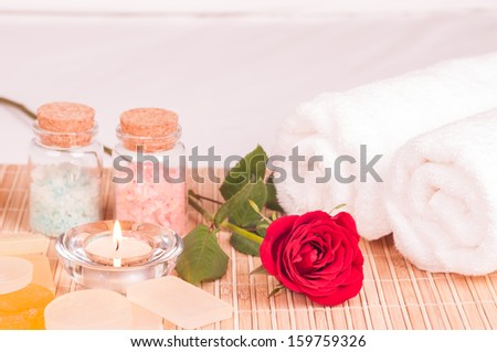 Romantic spa getaway with bath salts, soaps and towels close up  - stock photo