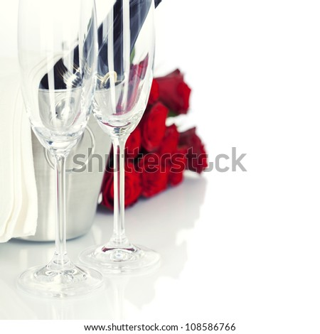 Romantic still life with champagne and beautiful red roses over white - stock photo