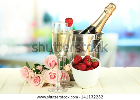 Romantic still life with champagne, strawberry and pink roses, on bright background - stock photo