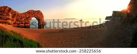romantic sunset scenery at durdle door beach, dorset - stock photo