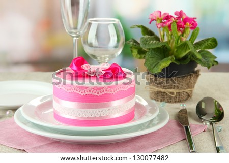 Romantic table serving on bright background