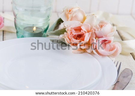 Romantic table setting. Mint and blush pink.  Selective focus.