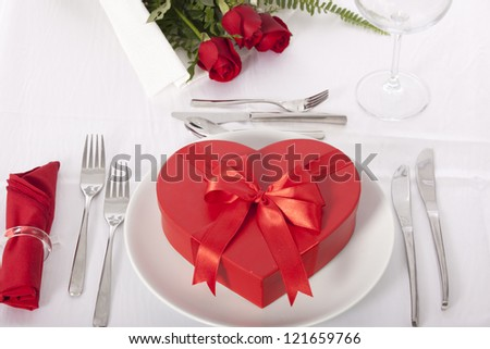 Romantic table setting with rose and chocolate box valentines day - stock photo