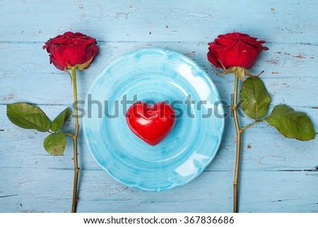 Romantic table setting with roses - stock photo