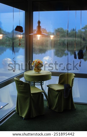 romantic table with flowers. - stock photo