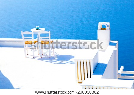 Romantic terrace restaurant, a table for the newlyweds. Oia Santorini, Greece - stock photo