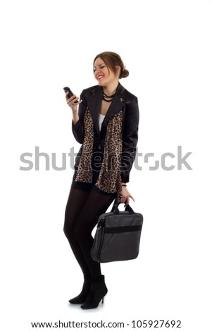 Romantic texting - Young businesswoman in a black suit with a laptop carrying bag, gets cheered up after reading a text message on her phone. - stock photo