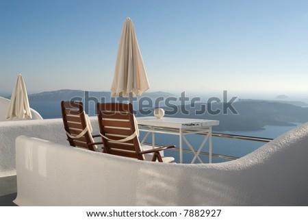 Romantic view over the caldera, vulcano in Santorini - stock photo