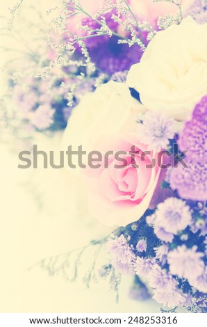 Romantic vintage White and purple roses bouquet on table. - stock photo