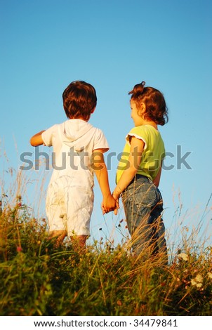 Romantic vision of two children standing together outdoor - stock photo