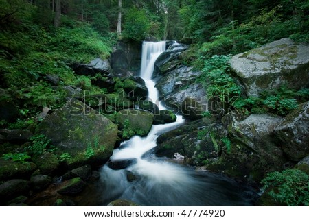 Romantic Waterfall inside the forrest - stock photo