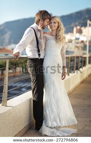Romantic wedding couple on sea-coast - stock photo