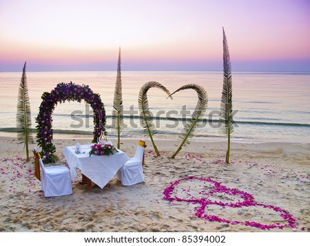 Romantic wedding dinner on a tropical beach in Thailand - stock photo