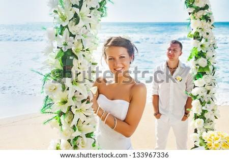 romantic wedding on the beach, bali (soft focus on bride) - stock photo
