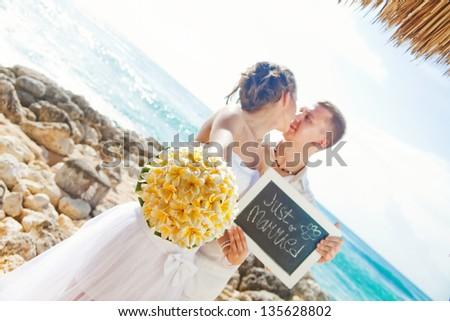 romantic wedding on the beach, bali (soft focus on flowers) - stock photo