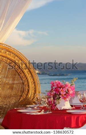 romantic wedding table set up on tropical beach - stock photo