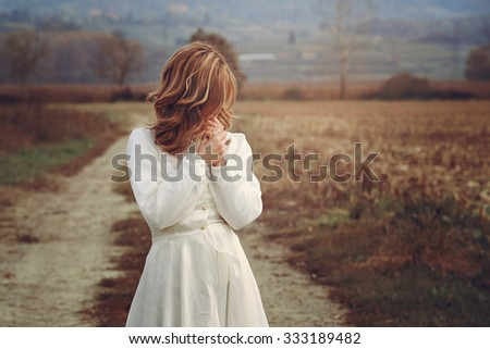 Romantic woman with vintage bride dress . Purity and innocence - stock photo