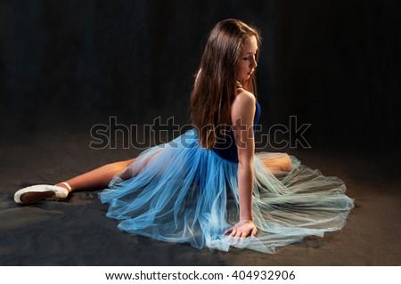 Romantic young ballerina posing in studio - stock photo