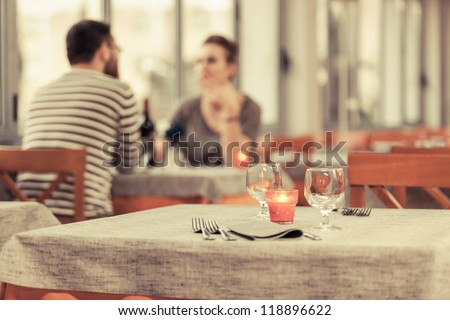 Romantic Young Couple at Restaurant - stock photo