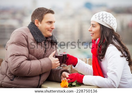 Romantic young couple drinking mulled wine - stock photo