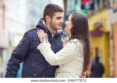 Romantic young couple embracing outdoors - stock photo