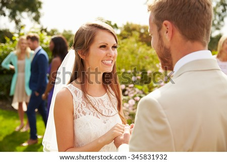 Romantic Young Couple Getting Married Outdoors - stock photo