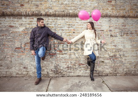 Romantic Young Couple Holding Hands - stock photo