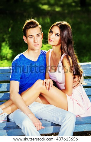 Romantic young couple in love having a rest together in the park. Romantic summer day.  - stock photo