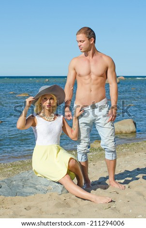 Romantic young couple near the sea.