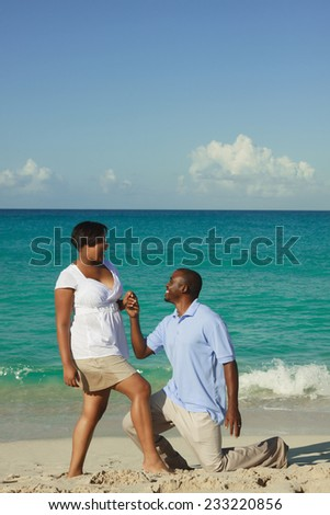 Romantic young couple on blue ocean background.