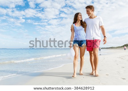 Romantic young couple on the beach - stock photo